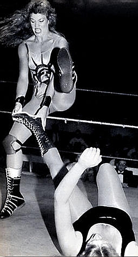 Peggy Lee Leather getting her leg worked over by Wendi Richter in a match in the AWA