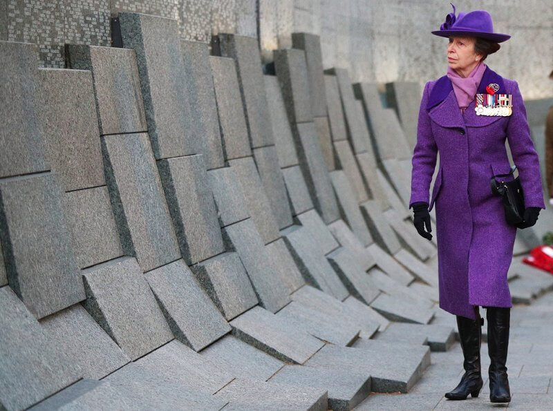 Princess Anne wore an eye-catching purple coat and matching hat, a pale lilac scarf and black knee-high boots