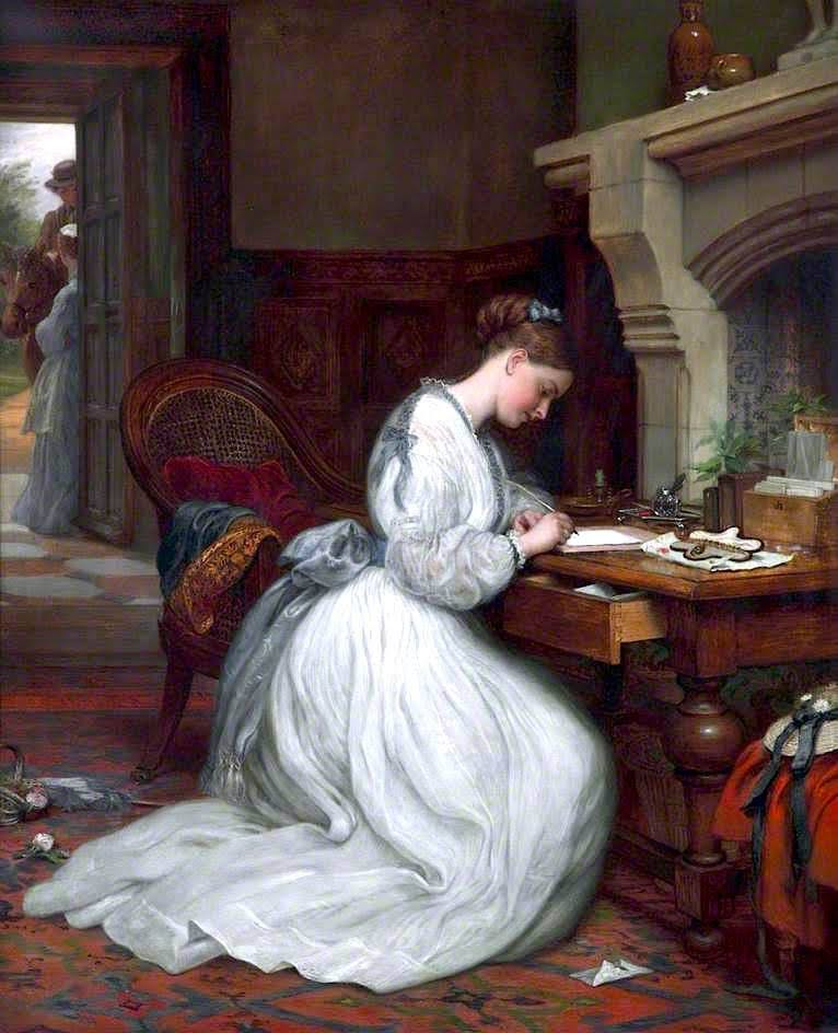Young woman is writing a letter