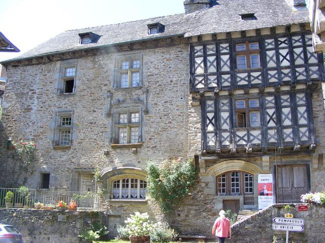 On the left, La Maison Henri IV, on the right La Maison Boyer, Ségur le Chateau, Correze, France. Photo by Loire Valley Time Travel..