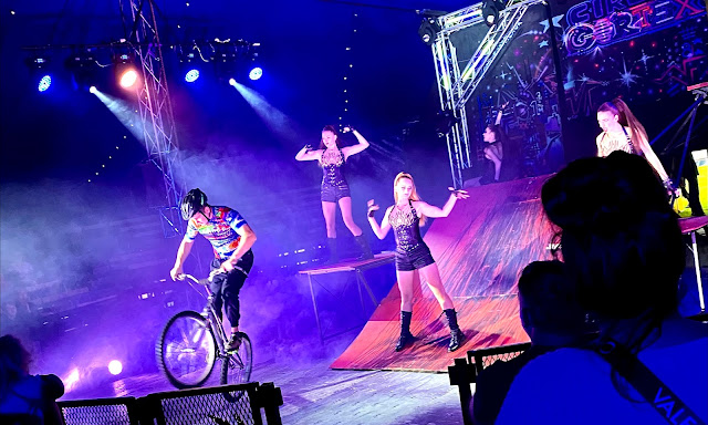 A BMX circus act with ramps and dancers