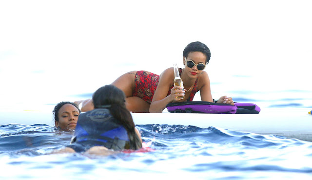 Rihanna looks gorgeous in a red swimsuit on her France holiday