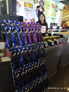 Racks of award ribbons during Meowcon 2019 made by Letra 'To Arts and Crafts