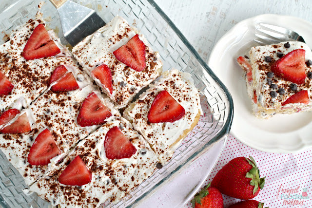 Sweet summer strawberries & a two classic Italian desserts come together perfectly in this no-bake Strawberry Cannoli Tiramisu.