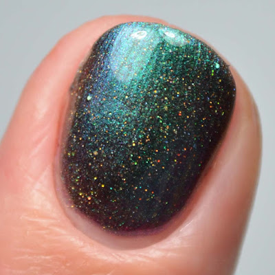 green multichrome nail polish close up