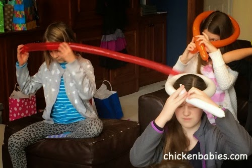twisting balloons at a tween girl birthday party