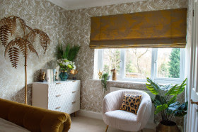 Ochre Yellow blind in a neutral shade room with a leaf pattern wallpaper