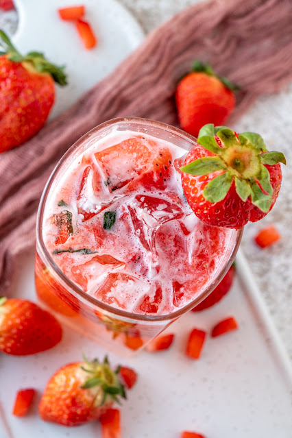 Drink shown from above with strawberry garnish