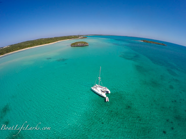 Sailing catamaran at anchor, Pau Pau Bay and South Palmetto Point, Eleuthera
