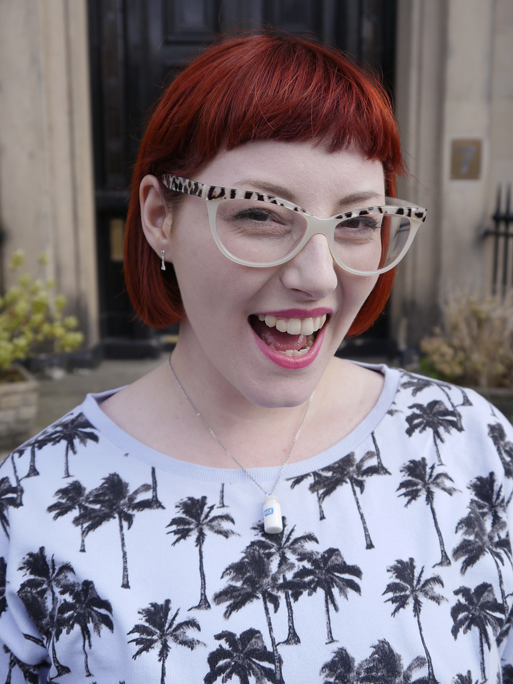 Scottish blogger, Edinburgh blogger, Scottish street style, quirky street style, dressing to a theme, food inspired outfit, pale girl style, Spex Pistols glasses, red head, red hair, H&M, patterned jumper, palm tree sweatshirt, white pleated dress, white boots, lace up shoes, milk necklace, Tiny Treat Boutique necklace, milk bottle jewellery, Lucky Dip Club, wear what you want