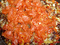 Tomatoes added to the pan