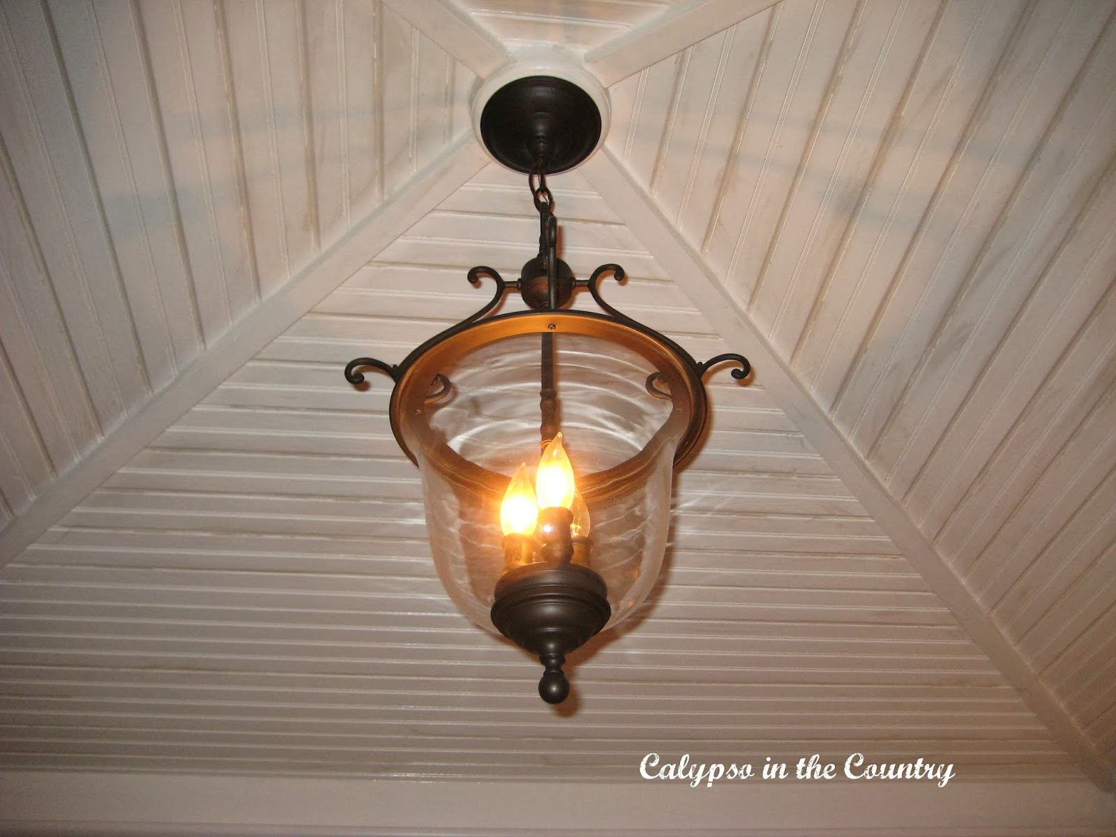 Bell light and beadboard ceiling