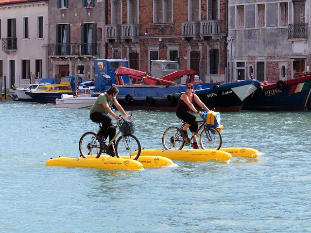 Water bikes on the Ponte Lungo canal, Murano, Venice
