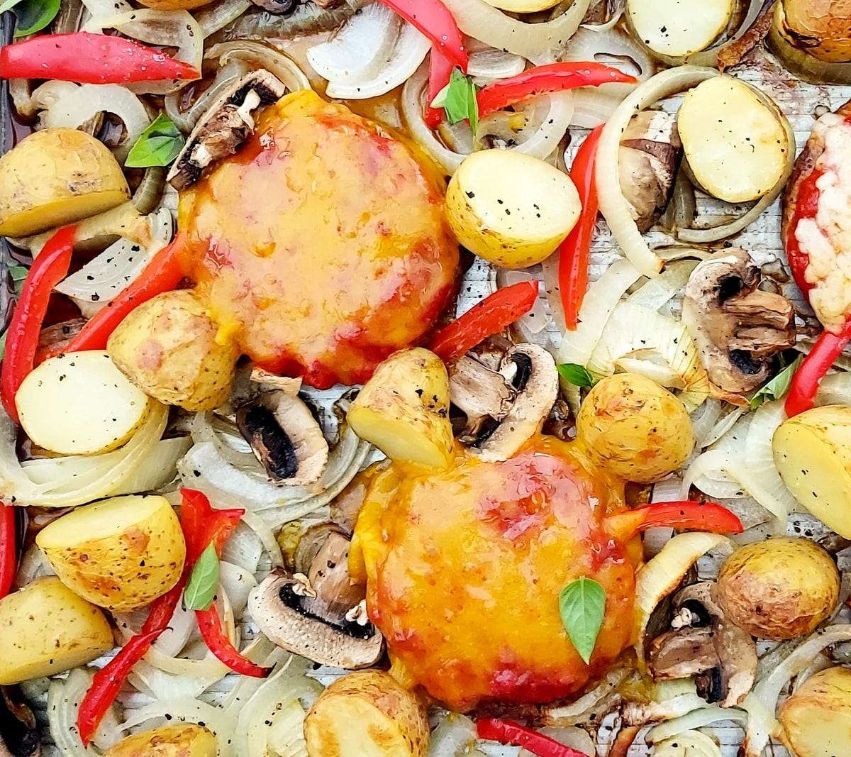close up of vegan burger and onion bake