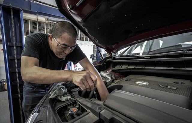 a-man-doing-car-maintenance