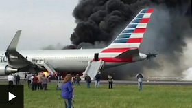 Plane Catches Fire At Chicago Airport