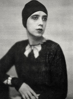 Schiaparelli models the knitted top with the trompe l'oeil collar that launched her career