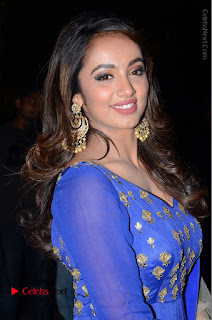 Telugu Actress Tejaswi Madivada Pos in Blue Long Dress at Nanna Nenu Na Boyfriends Audio Launch  0020.JPG