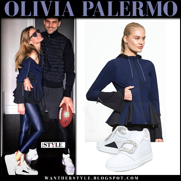 Olivia Palermo in navy peplum zip jacket jonathan simkhai saarinen, blue shinny leggings and white sneakers roger vivier sneaky viv what she wore super bowl 2017