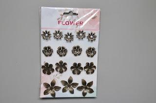 zakupy z action figurki elementy metalowe kwiaty