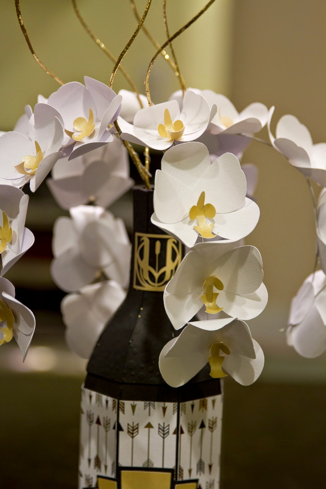 close up of orchids in champagne bottle