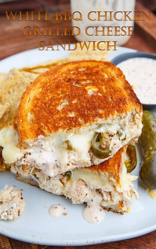 A hot melted grilled cheese sandwich stuffed with chicken in a white BBQ sauce, onions and pickled jalapenos! Ingredients 1 tablespoon butter 2 slices bread 2 slices gouda (or 1/2 cup shredded) 1/3 cup pulled chicken, warm 1 tablespoon white BBQ sauce (or to taste) 1 tablespoon onion, diced 1 tablespoon pickled jalapenos Directions Heat a pan over medium heat. Butter one side of each slice of bread, place one slice in the pan with buttered side down, top with half of the cheese, the mixture of the chicken and BBQ sauce, the onions, jalapenos, the remaining cheese and finally the other slice of bread with buttered side up. Grill until golden brown on both sides and the cheese is melted, about 2-4 minutes per side.
