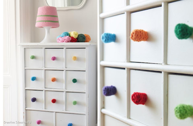 use Bright Colored balls of yarn instead of handles on the drawers