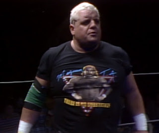 NWA Starrcade 1986 (The Skywalkers) - Dusty Rhodes wearing a Magnum TA t-shirt
