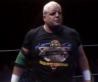 NWA Starrcade 1986 (The Skywalkers) - Dusty Rhodes wearing a Magnum TA t-shirt