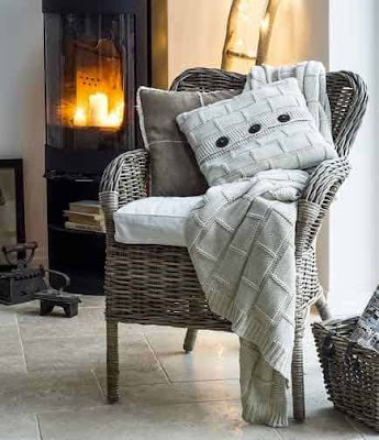 Accent armchair with pillow and throw.