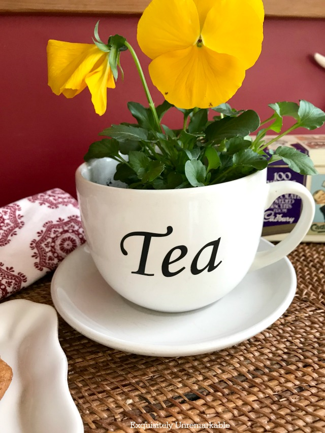 Pretty Tea Cup planter with pansies inside and tea on cup su