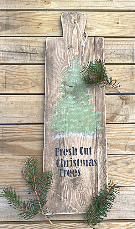Christmas tree stenciled bread board with pine boughs