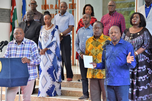 President Uhuru Kenyatta and Health CS Muthai Kagwe.  PHOTO | FILE