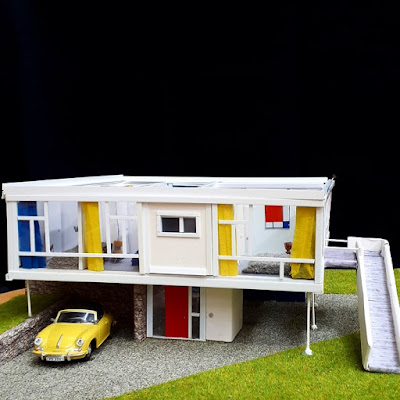 1/48-scale mid-century modern house in white with accents of bright colour.