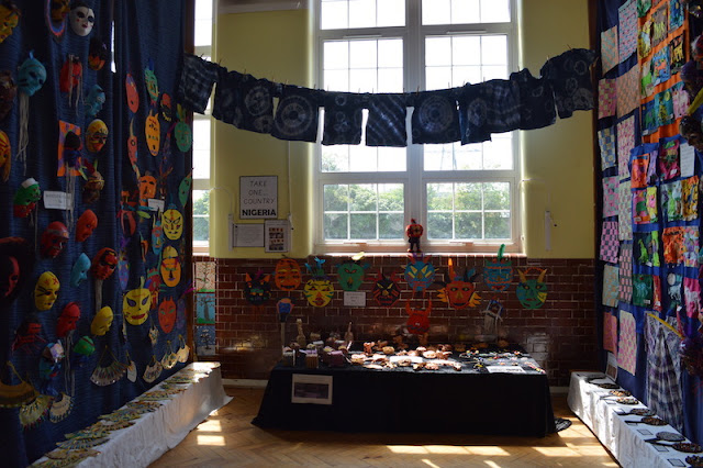 Photo of a large school hall displaying masks, pictures and sculptures