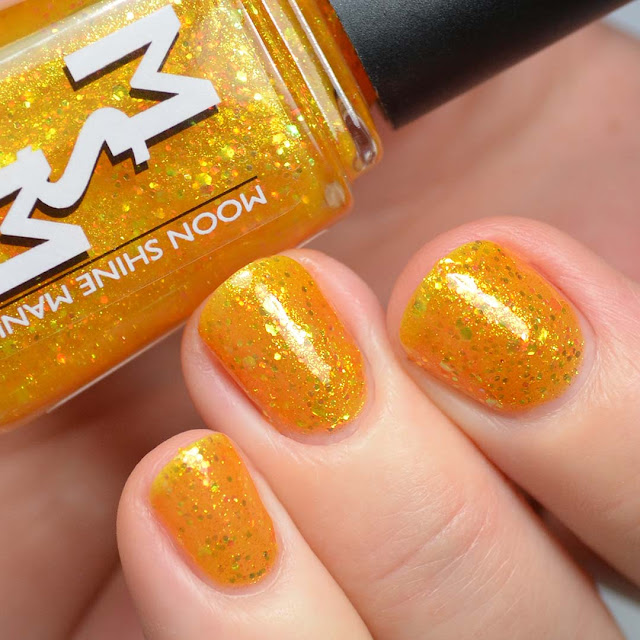 golden glitter jelly nail polish swatch