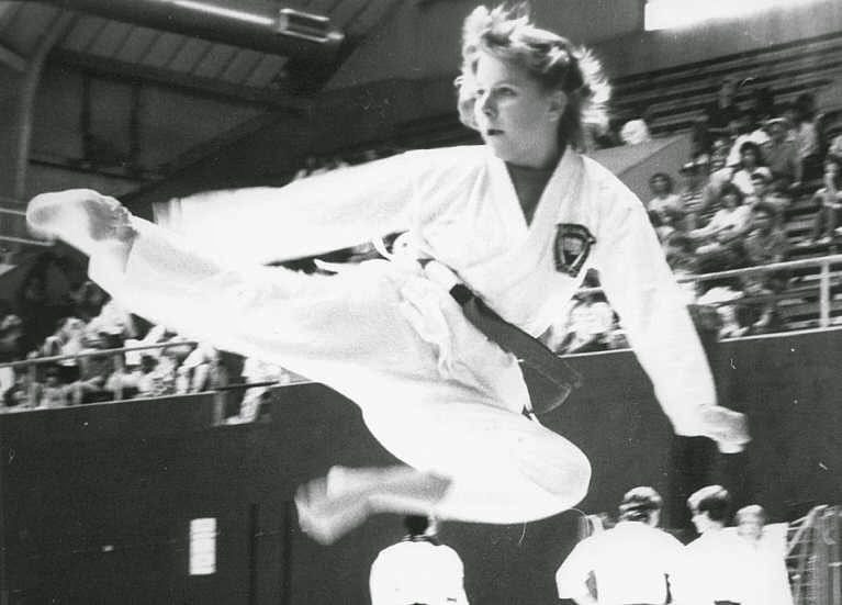 Martial arts instructor doing a flying kick