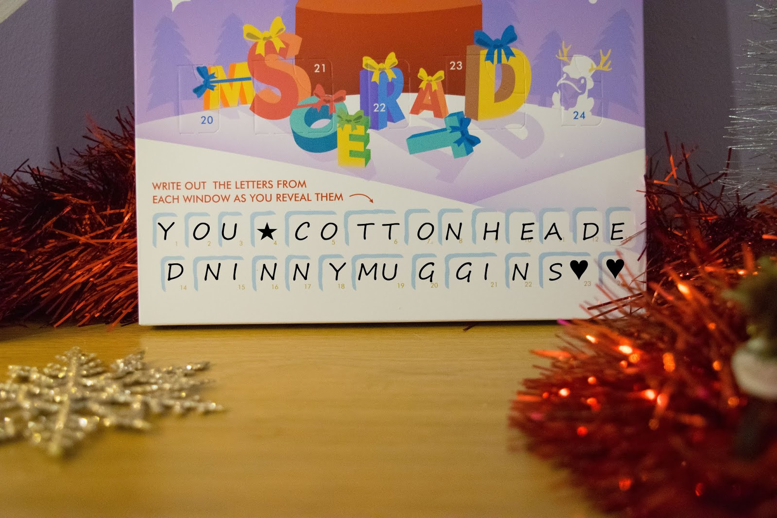 A mock-up of the bottom of the advent calendar with the letters of the secret message edited on top to show how it would look when the message has been written.