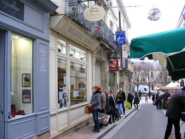 People queuing outside a bakery, Loches, Indre et Loire, France. Photo by Loire Valley Time Travel.