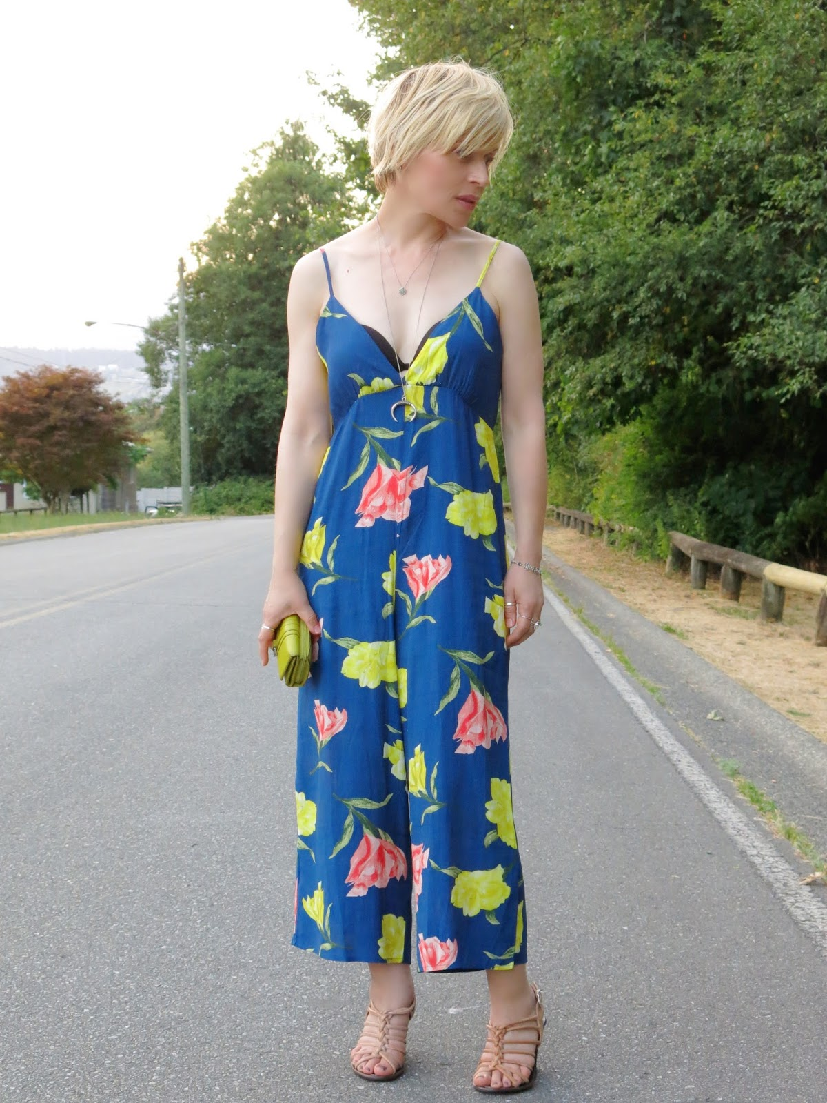 styling a cropped floral jumpsuit with strappy nude sandals