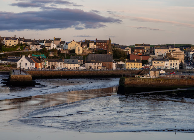 Photo of Maryport from across the basin at dusk