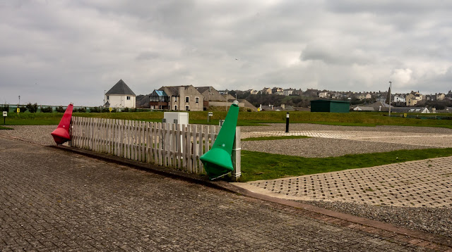 Photo of navigational buoys attached to the fence around the marina's caravan site