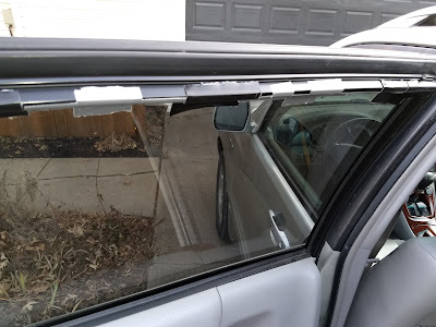 Broken car window held closed with duct tape