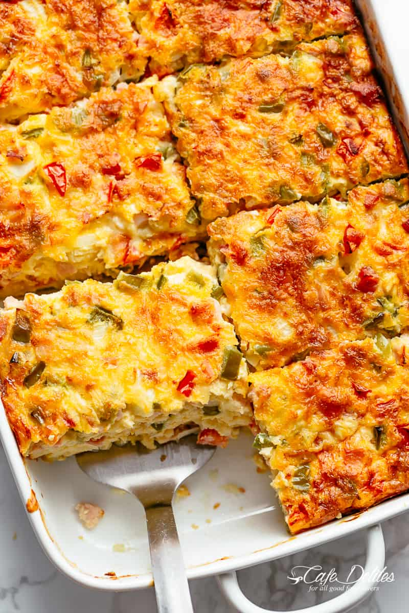 Easy to make Breakfast Casserole with shredded potato hash browns, sausage or bacon and mozzarella cheese! Loaded with green bell peppers, Roma tomatoes and onions, breakfast casserole is so easy to make!