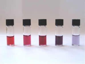 Selection of different solutions of gold nanoparticles, each with a different colour