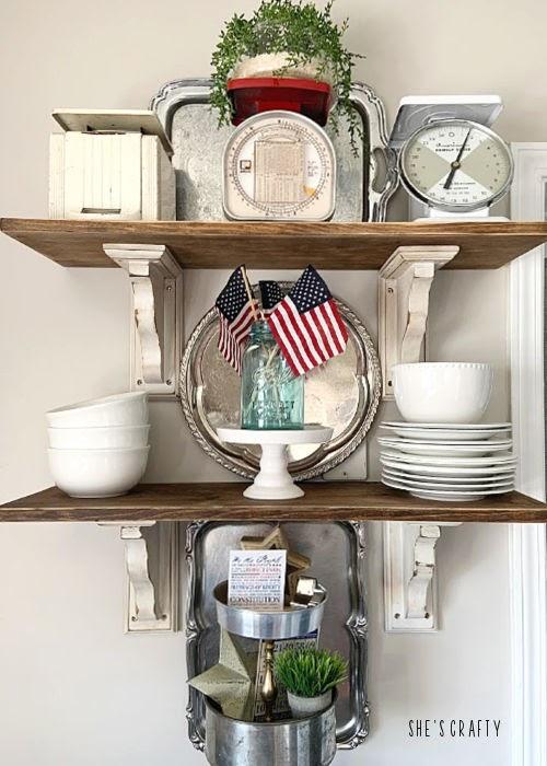 Last minute 4th of july decorating ideas - open kitchen shelves vignette- blue mason jars, flags, white dishes