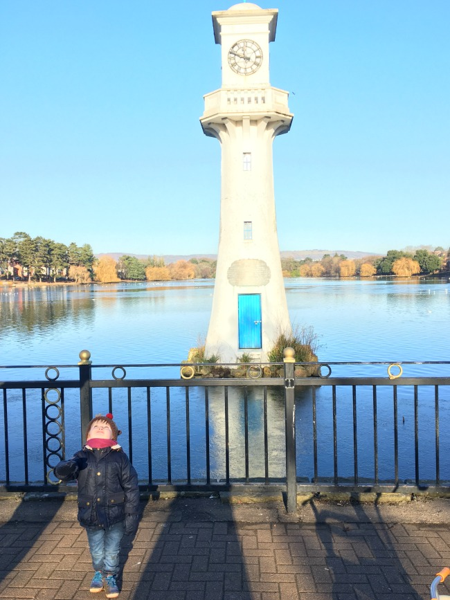 #MySundayPhoto-number-2-toddler-looking-at-sky-in-front-of-Scott-memorial-lighthouse-Roath-Park-Cardiff