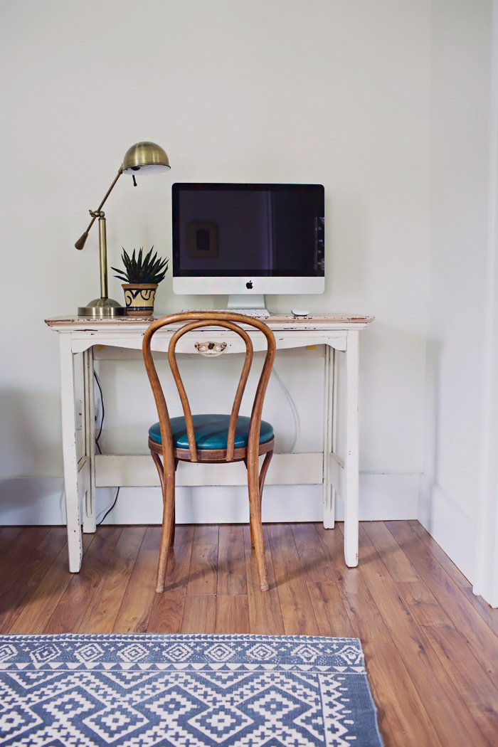 Vintage eclectic home office desk area with imac computer and bentwood chair