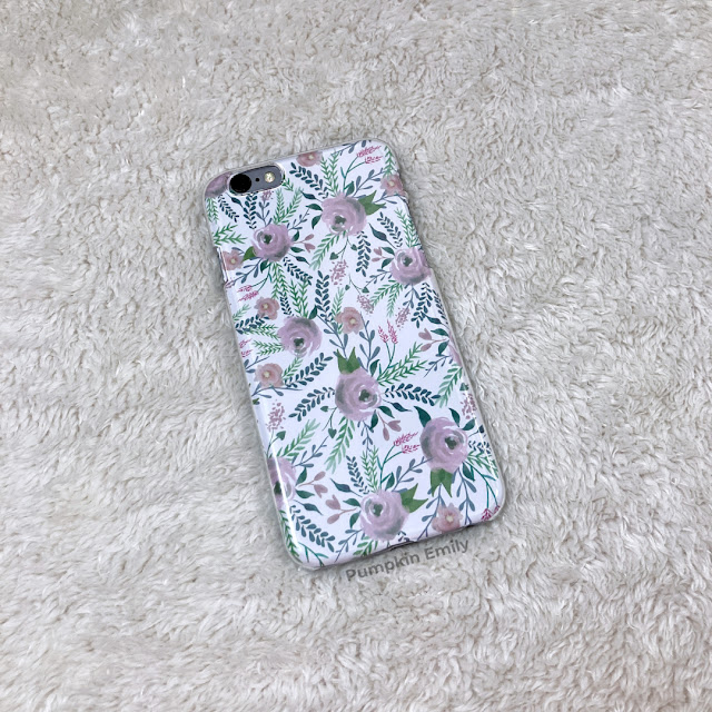 A clear phone case with scrapbook paper in it.