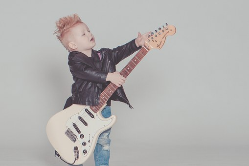 handsome baby boy with guitar